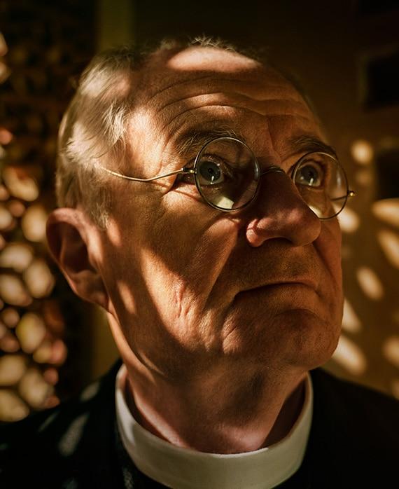 Jim Broadbent as Father Roberts